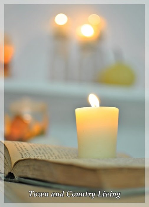 Reading a Book by Candlelight