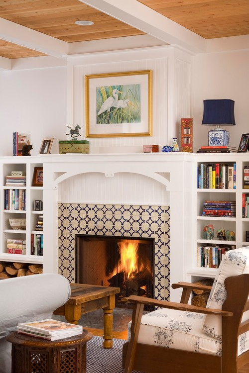 White Fireplace with Built-in Bookcases