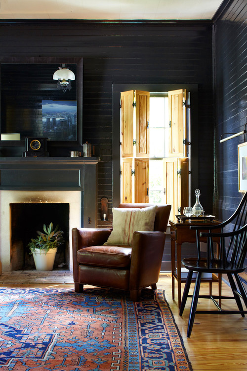 Historic Farmhouse Style Living Room with Black Shiplap Walls