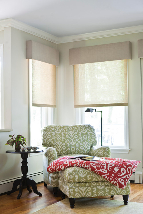 Cozy Reading Corner with Green Patterned Chair and Ottoman