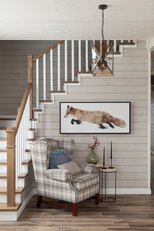 Quaint Cottage Entryway with Shiplap Stairway Walls