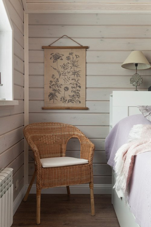 Neutral Bedroom with Shiplap Walls and Wicker Chair