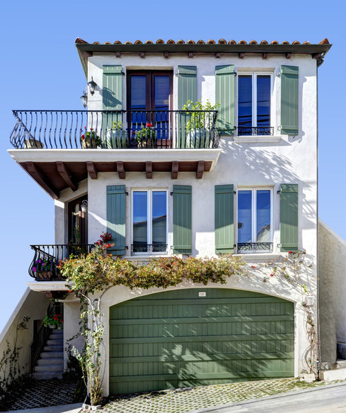 Mediterranean Style Home with Two Story Partial Porch