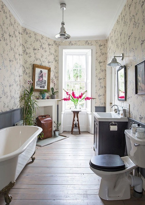 Vintage Bathroom with Fireplace and Claw Foot Tub