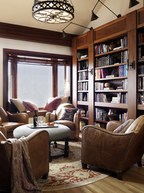 Warm and Cozy Living Room with Leather Furniture and Built-In Bookcase