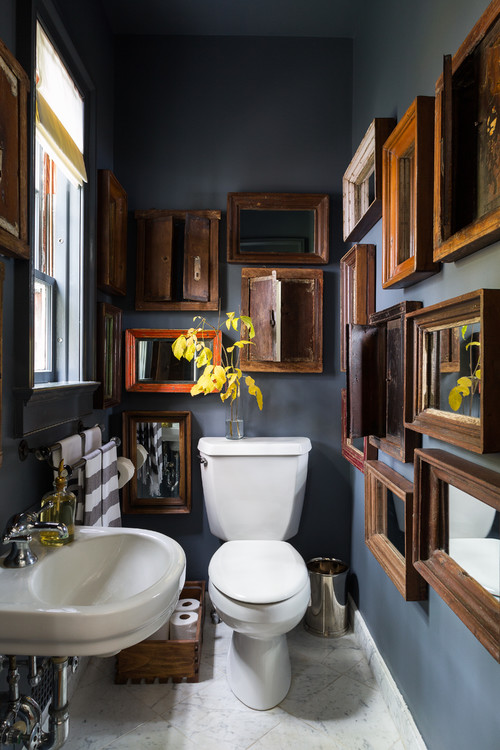 Dark Gray Bathroom with Vintage Wall Decor and Mirrors