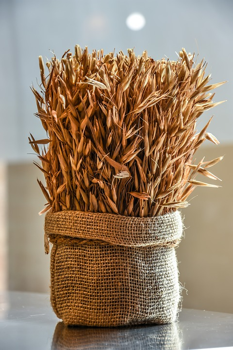 Centerpiece of Dried Wheat in Burlap Sack