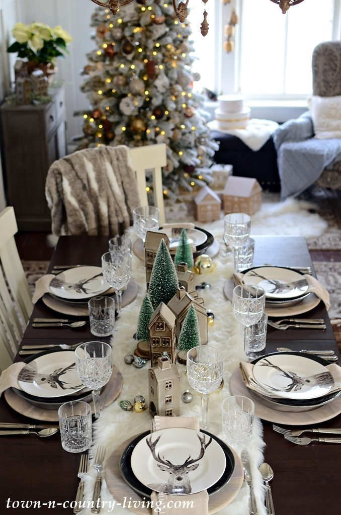 Christmas Table Setting with Reindeer Plates and Waterford Crystal