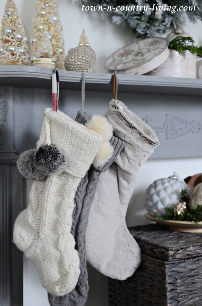 Cable Knit and Faux Fur Christmas Stockings on a Gray Mantel
