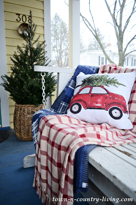 Christmas Pillow on Front Porch Swing