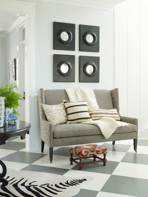 Entryway with Checkerboard Floor and Upholstered Bench