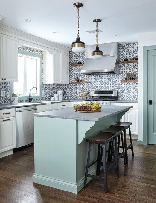 Pastel Green and White Kitchen with Patterned Tile Backsplash