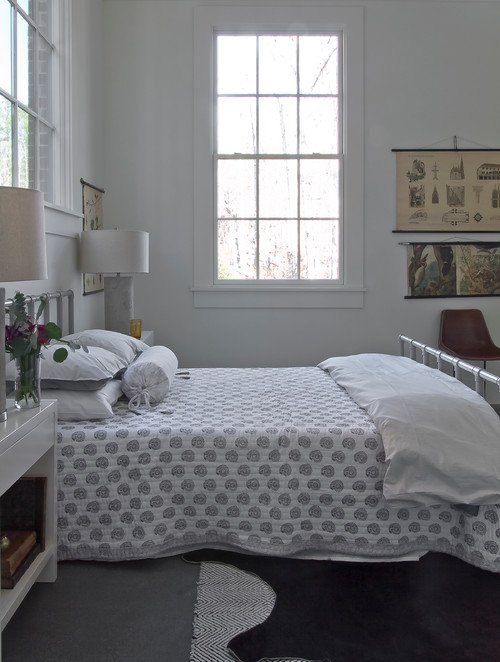 Scandinavian Style Bedroom with Metal Bed and Simple Quilt