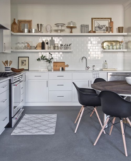 White Scandinavian Style Kitchen with Black Eames Dining Chairs