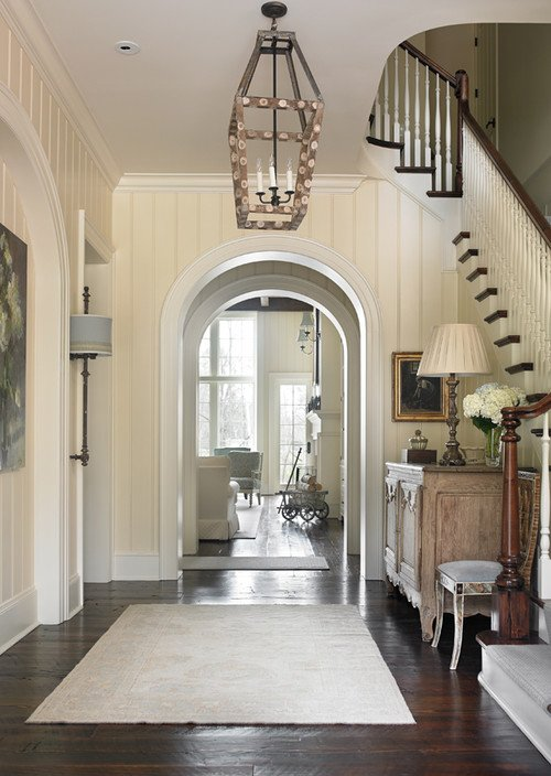 Traditional Foyer with Arched Doorways