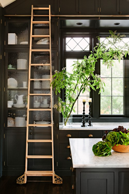Black Kitchen Cabinets with Rolling Wood Ladder