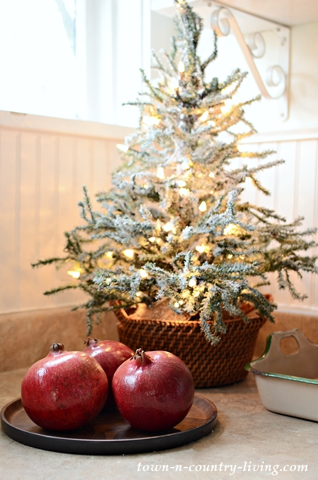 Little Christmas Tree in the Kitchen with Pomegranates