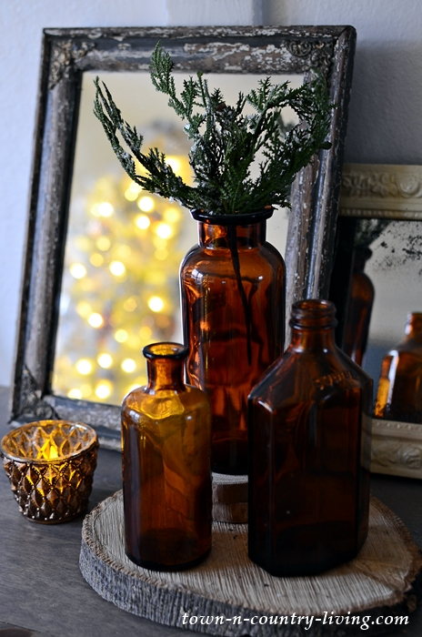 Brown Bottle Christmas Vignette with Evergreen