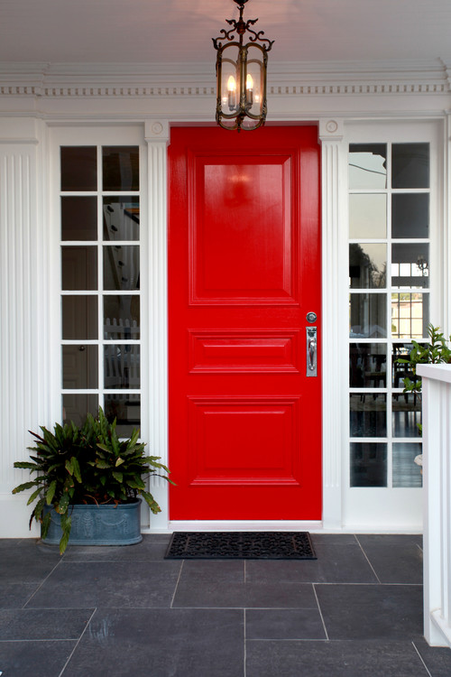 Classic White House with a Red Front Door and Sidelight