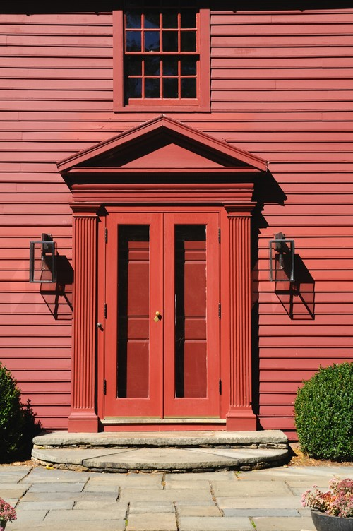 Red Colonial Style Home with Matching Front Door