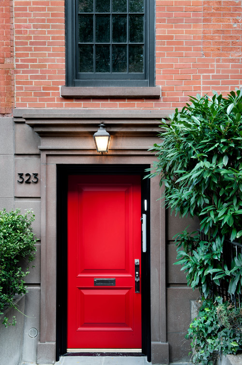 Gray and Red Brick House with Painted Red Door