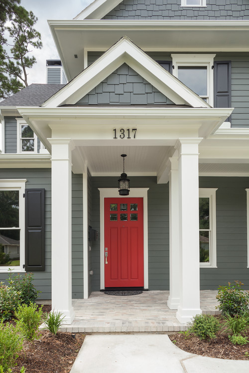 Gray Traditional Two-Story Home with Red Door