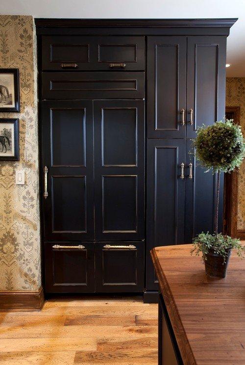 Refrigerator concealed with black kitchen cabinet doors