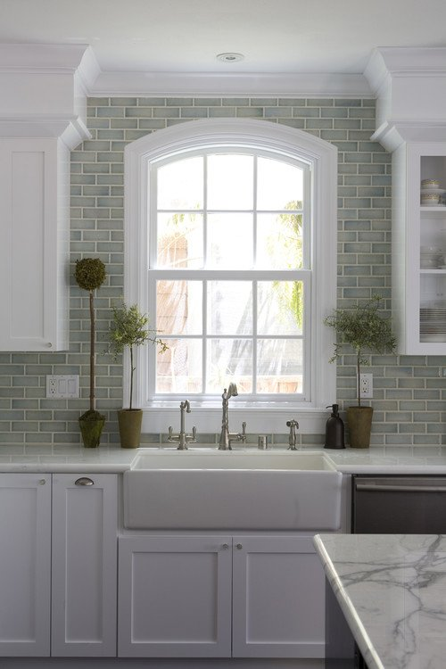 Topiary Plants Frame a Kitchen Window