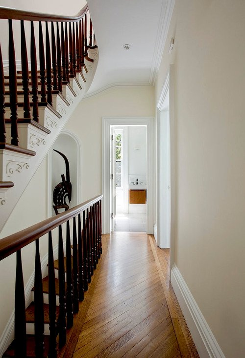 Traditional Staircase in Row House Entryway