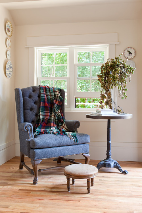 Blue Wing Chair with Plaid Throw in Sun Room