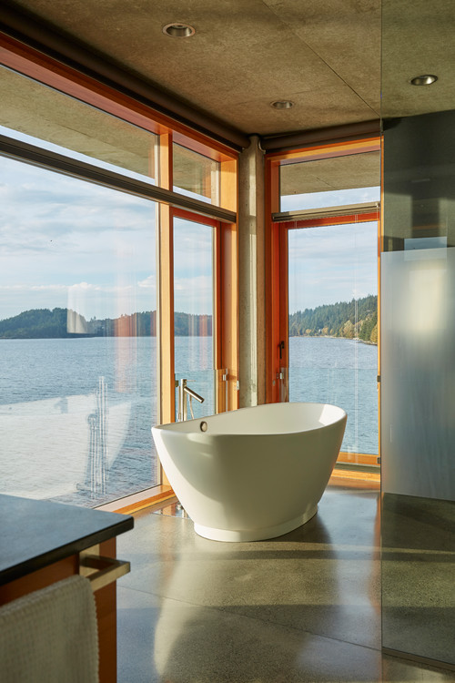 Freestanding Tub in a Bathroom with a Lake View