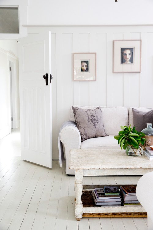 Farmhouse Living Room with Floors Painted White