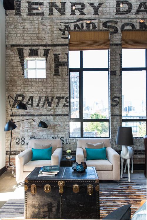 Steamer Trunk Used as Coffee Table in Industrial Living Room Loft