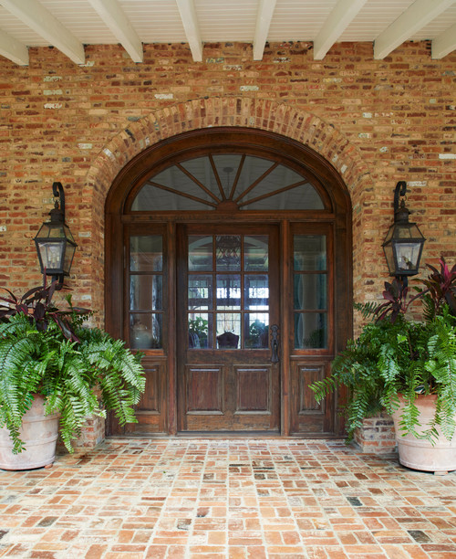 Arched Wood Doorway in Brick Georgian Home