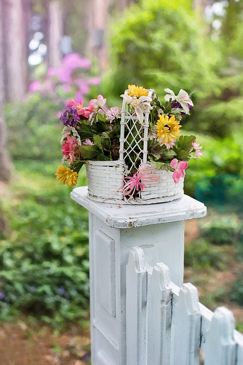 White Picket Fence with Flower Pot