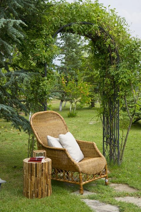 Garden Arbor with Wicker Chair