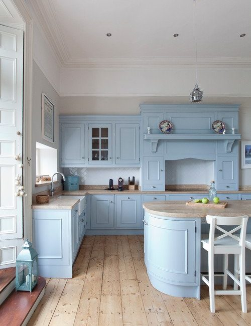 Powder blue kitchen cabinets and natural wood floor