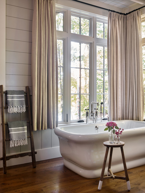 Elegant Free Standing Bath Tub in Rustic Bathroom