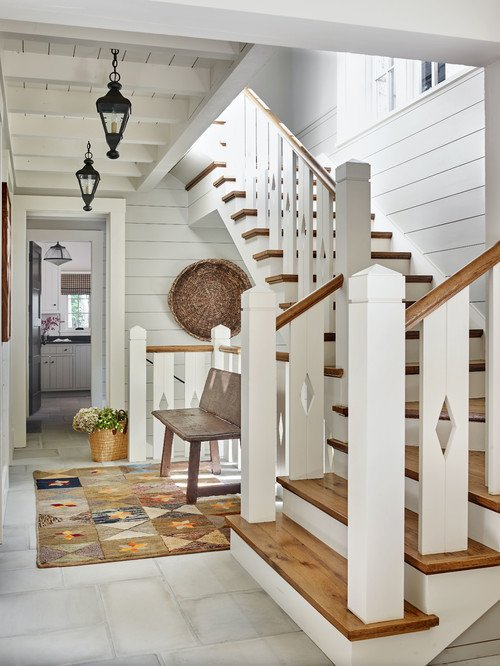 Wood and White Staircase in Rustic Lake Home