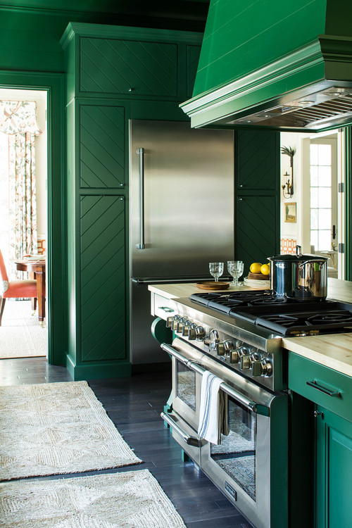 Dark Green Kitchen Cabinets with Stainless Steel Appliances