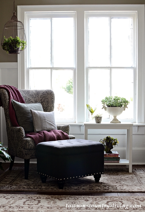 Welcoming Entryway with Wing Chair and Plant Table
