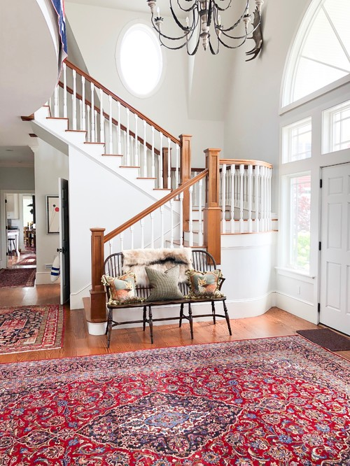Entryway with grand staircase and oriental rug