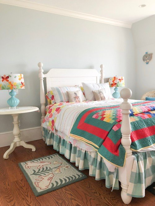 White Cannonball Bed with Colorful Block Quilt