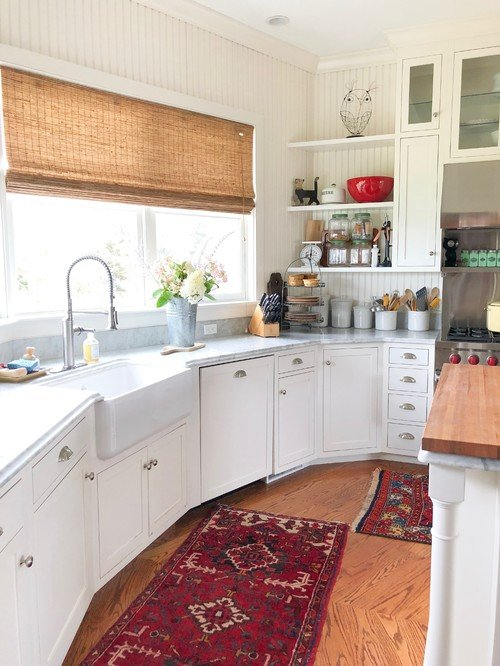 White Kitchen with Colorful Oriental Rugs