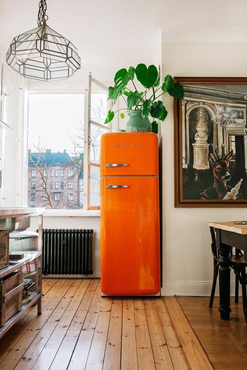 Orange Smeg Refrigerator in Boho Chic Kitchen