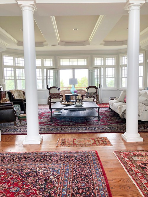 Elegant Maine Home Living Room with Pillars and Oriental Rugs