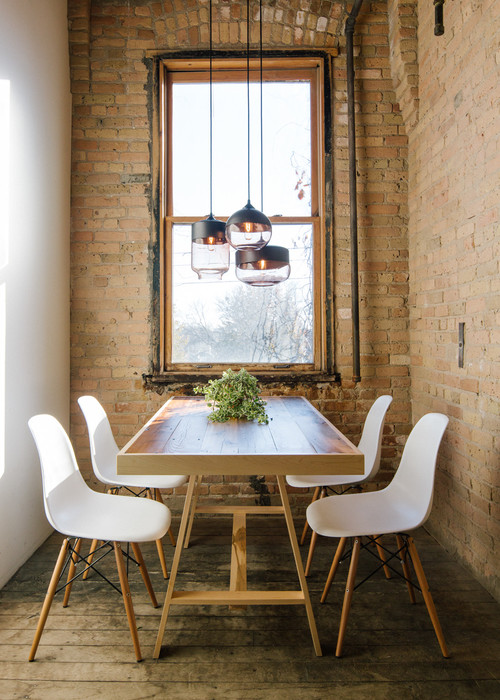 Small Dining Room with Window and Brick Wall