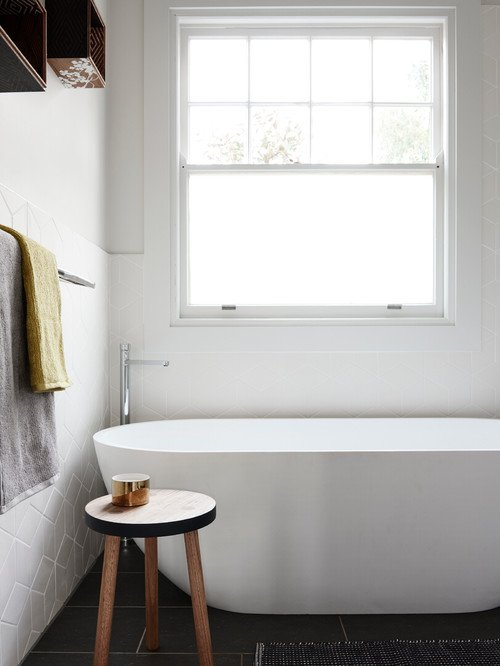 Freestanding Tub in White Minimalist Style Bathroom