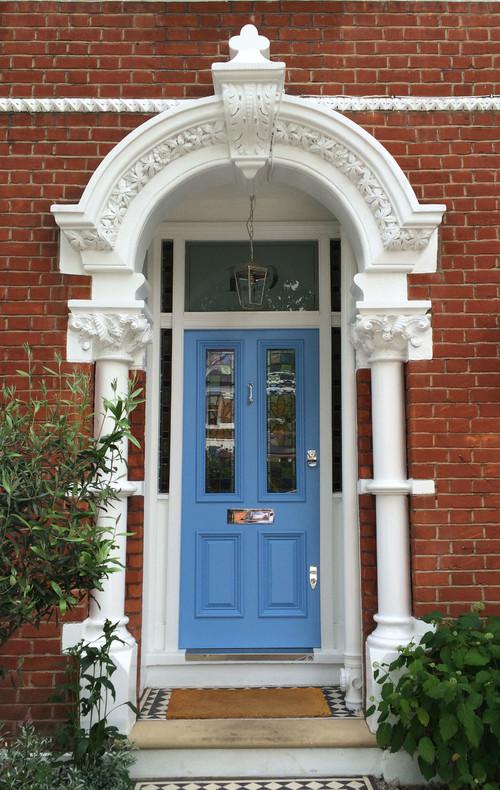 Red Brick Home with Blue Front Door