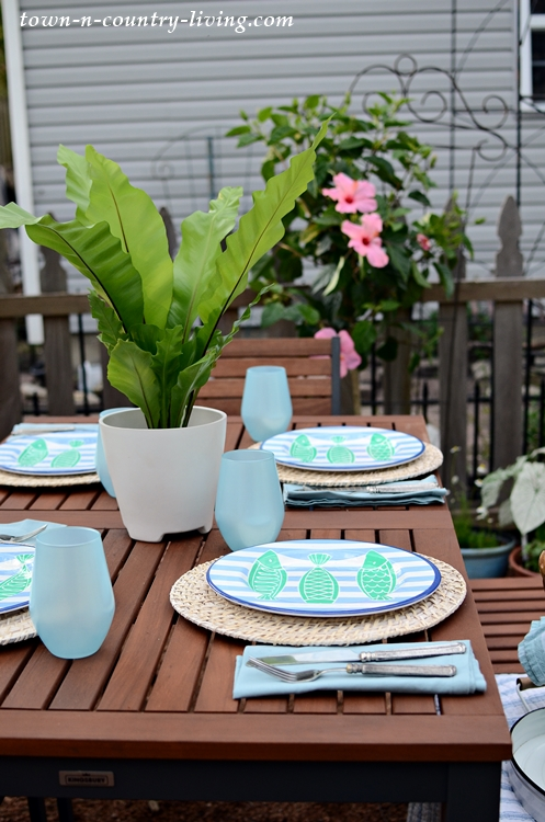 Melamine Plates and Blue Glasses for Summer Table Setting